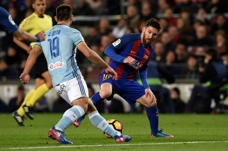 Barcelona's forward Lionel Messi (R) vies with Celta Vigo's defender Jonny Castro during the Spanish league football match FC Barcelona vs RC Celta de Vigo at the Camp Nou stadium in Barcelona on March 4, 2017