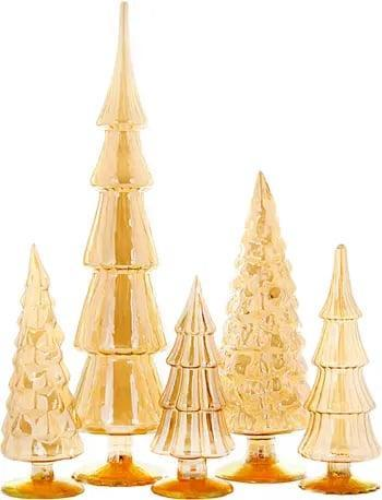 <p>If you don't have enough square footage for a full-fledged tree, downsize your setup with these <span>Cody Foster &amp; Co. Set of 5 Glass Trees</span> ($199). The gilded finish feels oh-so glam.</p>