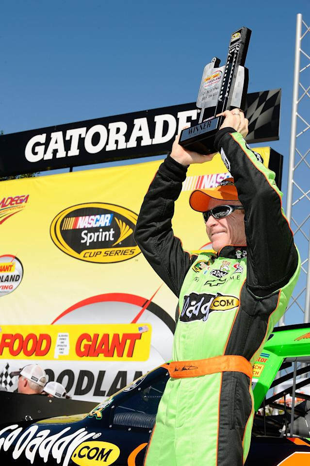 TALLADEGA, AL - OCTOBER 22:  Mark Martin, driver of the #5 GoDaddy.com Chevrolet, celebrates setting the pole position in qualifying for the NASCAR Sprint Cup Series Good Sam Club 500 at Talladega Superspeedway on October 22, 2011 in Talladega, Alabama.  (Photo by Jared C. Tilton/Getty Images for NASCAR)