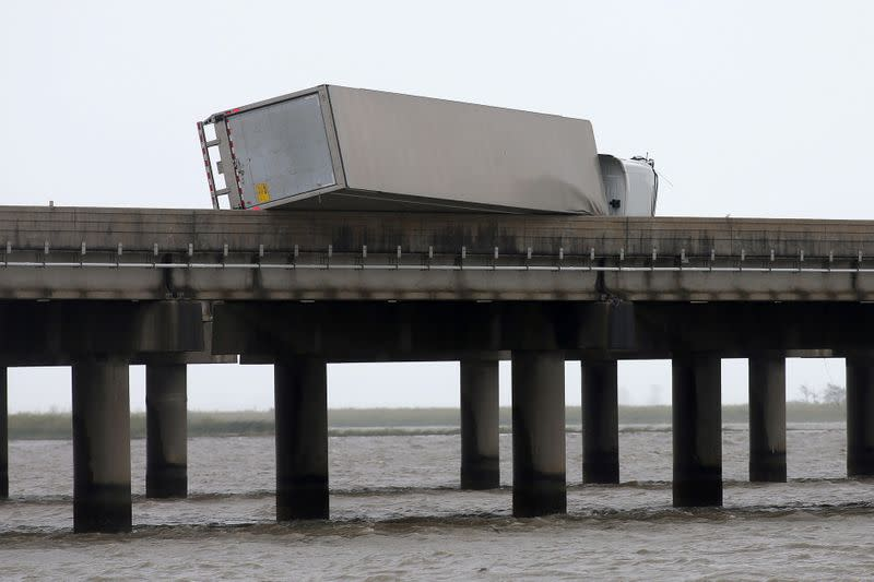 A flipped over trailer is pictured on I-10 East during Hurricane Sally in Mobile