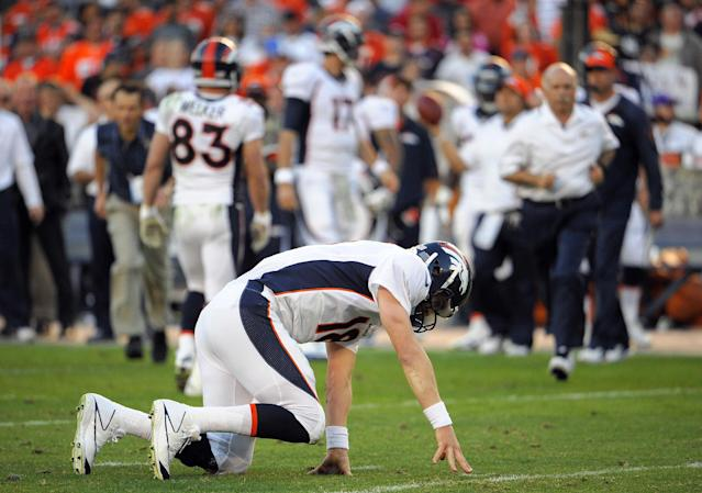 Denver Broncos quarterback Peyton Manning (18) falls to the ground during the fourth quarter of an NFL football game against the San Diego Chargers, Sunday, Nov. 10, 2013, in San Diego. The Broncos won 28-20. (AP Photo/Denis Poroy)