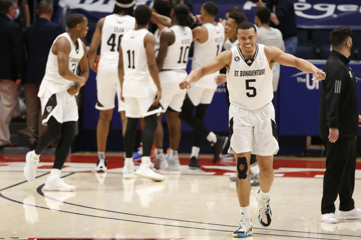 St. Bonaventure's Jaren Holmes, right, celebrates after beating VCU in an NCAA college basketball championship game for the Atlantic Ten Conference tournament Sunday, March 14, 2021, in Dayton, Ohio. St. (AP Photo/Jay LaPrete)