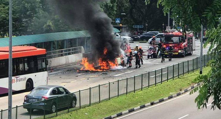 SCDF officers putting out the blaze after a Trans-Cab taxi caught fire along Commonwealth Avenue. (PHOTO: Facebook page of Red Seo Hong Heng)