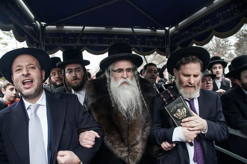 Rabbi Chaim Rottenberg celebrates with people the arrival of a new Torah at his residence in Monsey