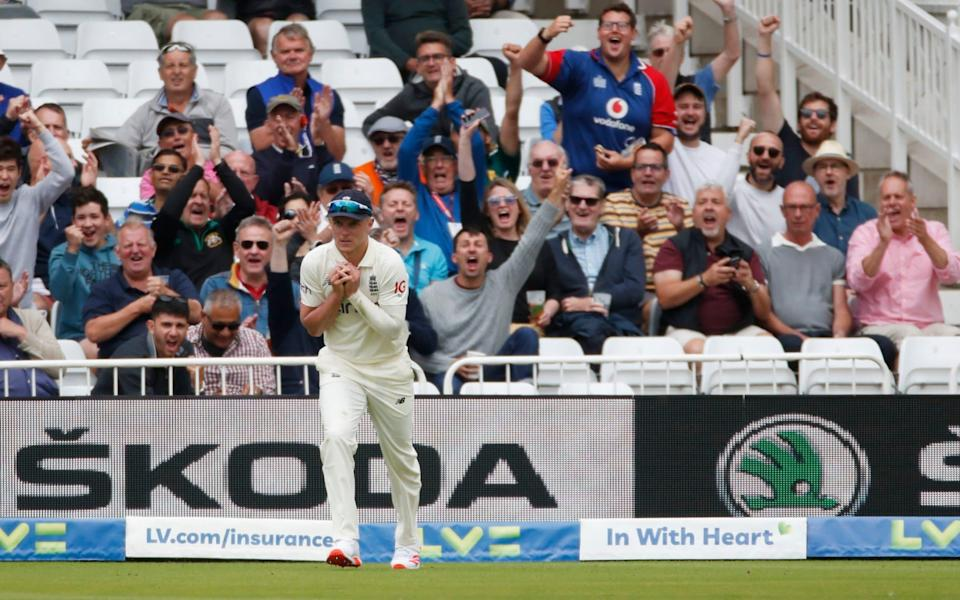 England's Sam Curran takes a catch to dismiss India's Rohit Sharma - Action Images via Reuters/Paul Childs
