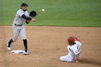 Washington Nationals' Luis Garcia, right, is out at second as Miami Marlins shortstop Miguel Rojas, left, throws to first to get out Carter Kieboom and compete a double-play during the sixth inning of the first baseball game of a doubleheader, Saturday, Aug. 22, 2020, in Washington. (AP Photo/Nick Wass)