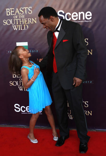 """Actress Quvenzhané Wallis and actor Dwight Henry arrive at the movie premiere of """"Beasts Of The Southern Wild"""" at the Joy Theater in New Orleans, Monday, June 25, 2012. (AP Photo/Gerald Herbert)"""
