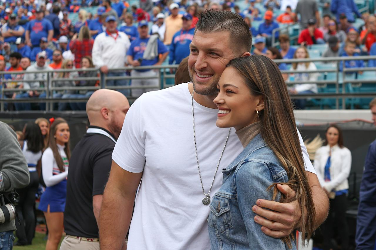 """<p>Former NFL quarterback Tim Tebow wed Miss Universe 2017 Demi-Leigh Nel-Peters in a sunset ceremony at <a href=""""http://www.laparis.co.za/"""" target=""""_blank"""">La Paris Estate</a> in Cape Town, South Africa, on January 18, 2020. According to the couple, the wedding was traditional, but they each made sure to add in their own twists. """"I want the vows to be perfect,"""" Tebow <a href=""""https://people.com/sports/tim-tebow-and-demi-leigh-nel-peters-are-married-my-dreams-have-come-true/"""">told <em>People</em></a> the night before the wedding. """"I'm leaving in the traditional things like 'till death do us part,' but I'm also adding some of my own things to it.""""</p> <p>Nel-Peters added, """"We're both very traditional. We wanted to look back at the wedding and see that it was intimate, elegant, and traditional. We definitely wanted it to be something that we could look back on and know that nothing was dated. We want to remember this day for the rest of our lives.""""</p> <p>For the event with 260 guests, Nel-Peters donned an elegant sleeveless custom gown by David's bridal, <em>People</em> reports. And for their rehearsal dinner under the stars, the bride donned a beaded red jumpsuit while Tebow wore a brocade maroon suit. The football star shared <a href=""""https://www.instagram.com/p/B7gJWvVg4u3/"""">stunning pictures and videos</a> of the dinner to his social media, captioning it, """"Blending Cultures + Traditions, Grateful.""""</p>"""