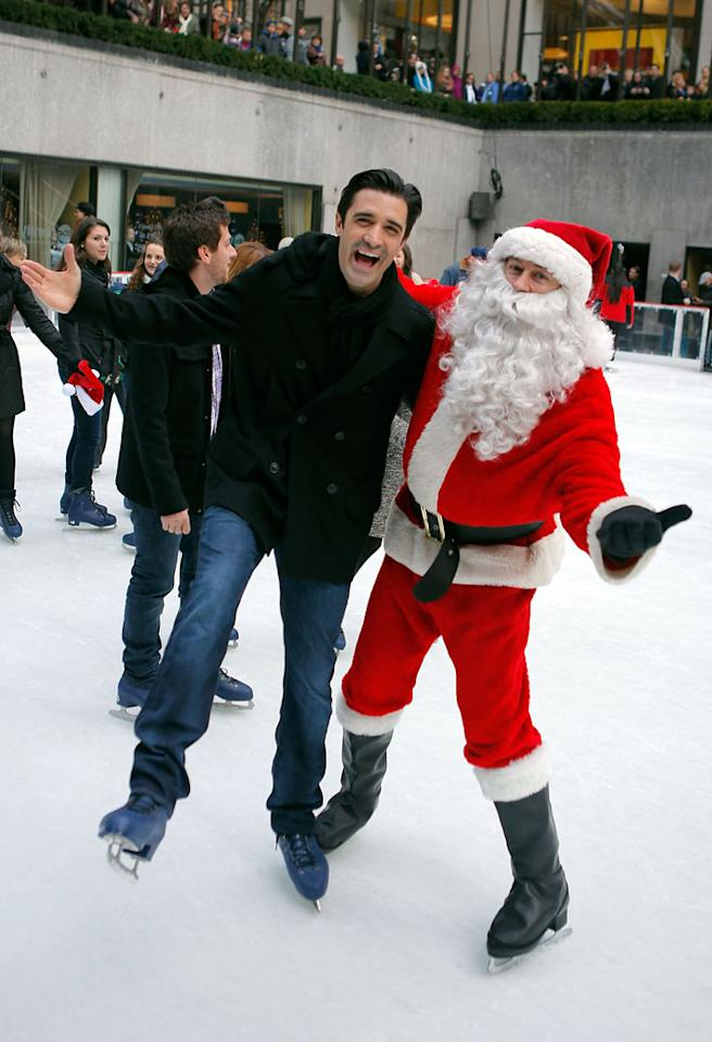 "NEW YORK, NY - DECEMBER 02:  (L-R) Actors Gilles Marini and Santa Claus skate at Rockefeller Center Ice Rink during ABC Family's ""25 Days Of Christmas"" Winter Wonderland Event at Rockefeller Center on December 2, 2012 in New York City.  (Photo by J. Countess/WireImage)"