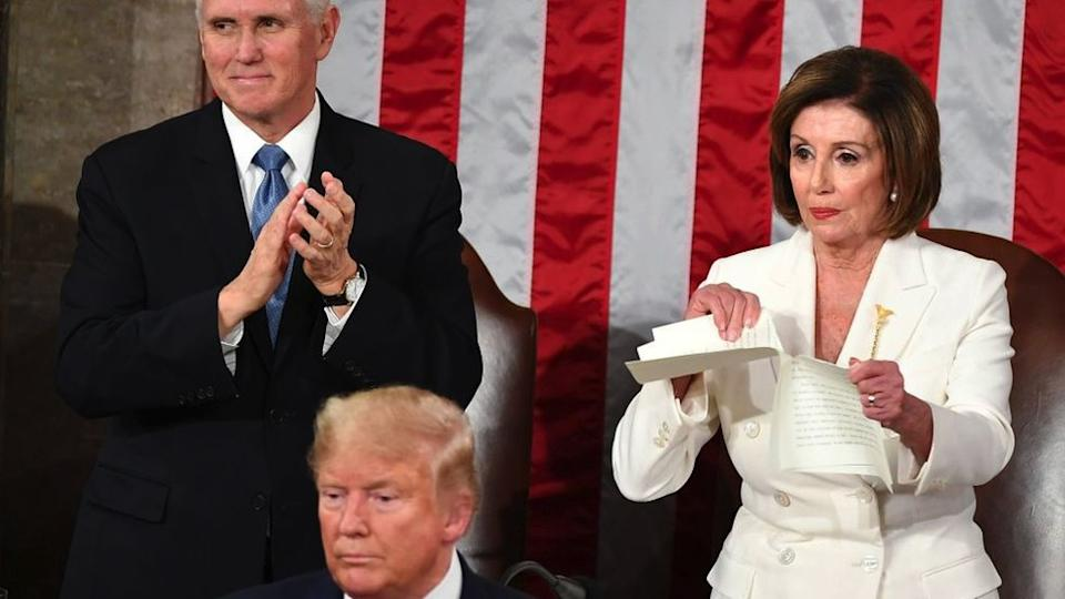 Speaker of the US House of Representatives Nancy Pelosi rips a copy of US President Donald Trumps speech after he delivered the State of the Union address at the US Capitol in Washington, DC, on February 4, 2020.