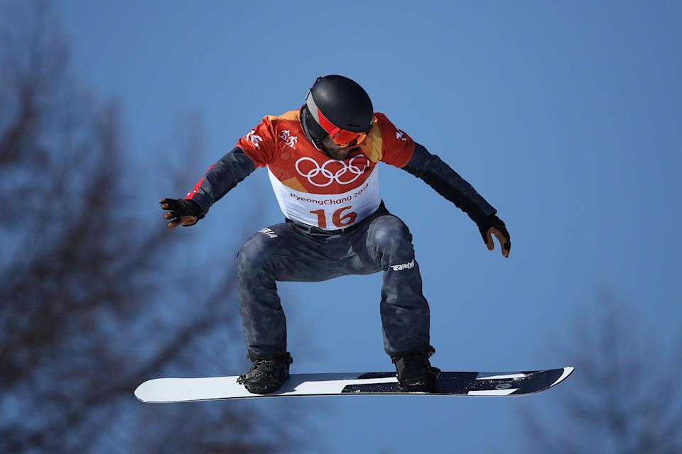 Markus Schairer during the men's snowboard cross quarterfinals at the 2018 Olympics, before his crash. (Getty)