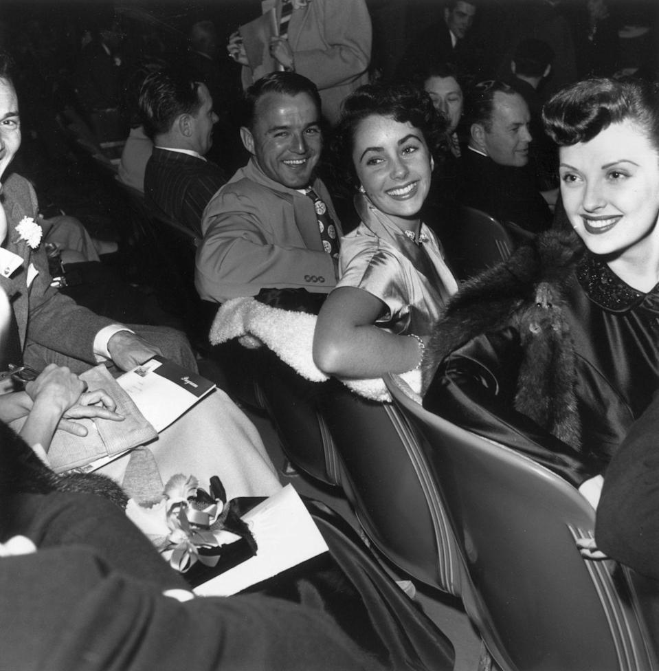 <p>Elizabeth and her boyfriend, American football player and Heisman Trophy winner Glenn Davis, attend a movie premiere together in 1945. The pair began dating while Glenn was on leave from the Army. </p>