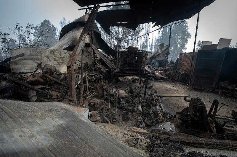 The wreckage of a garage in an area devastated by a wildfire close to the village of Figueiro dos Vinhos, where more than 1,000 firefighters are still trying to control the huge forest fire (AFP Photo/MIGUEL RIOPA)