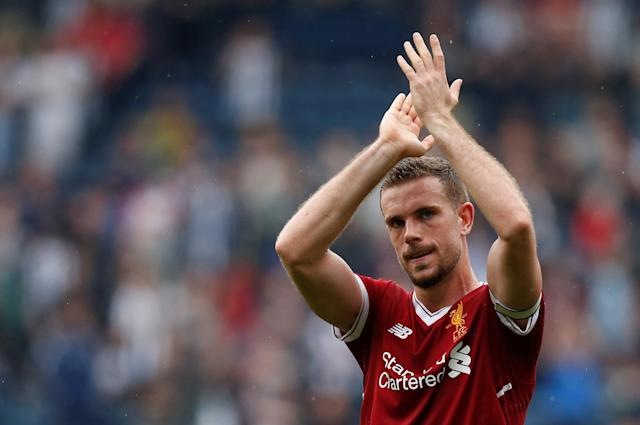 """Soccer Football - Premier League - West Bromwich Albion v Liverpool - The Hawthorns, West Bromwich, Britain - April 21, 2018 Liverpool's Jordan Henderson applauds fans after the match REUTERS/Andrew Yates EDITORIAL USE ONLY. No use with unauthorized audio, video, data, fixture lists, club/league logos or """"live"""" services. Online in-match use limited to 75 images, no video emulation. No use in betting, games or single club/league/player publications. Please contact your account representative for further details."""