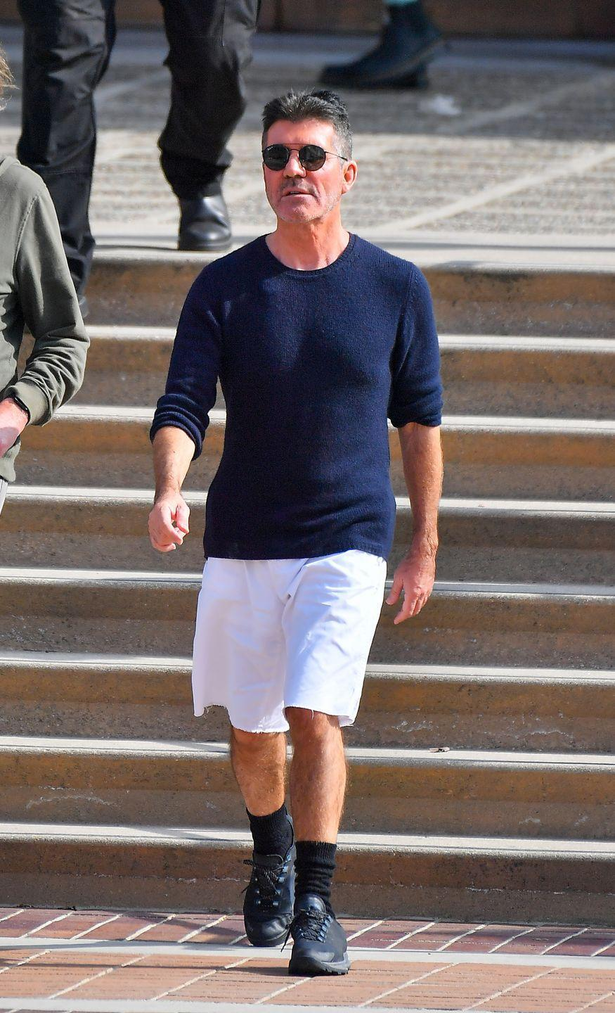 """<p>In 2019, Simon Cowell revealed that he lost about <a href=""""https://www.prevention.com/weight-loss/a27889059/simon-cowell-weight-loss-diet/"""" rel=""""nofollow noopener"""" target=""""_blank"""" data-ylk=""""slk:20 pounds"""" class=""""link rapid-noclick-resp"""">20 pounds</a> in an effort to be healthier, which was inspired by a scary fall he took in 2017 due to low blood pressure. Since then, the <em>America's Got Talent </em>judge <a href=""""https://www.prevention.com/food-nutrition/healthy-eating/a29088480/no-dairy-diet/"""" rel=""""nofollow noopener"""" target=""""_blank"""" data-ylk=""""slk:stopped eating dairy"""" class=""""link rapid-noclick-resp"""">stopped eating dairy</a>, wheat, and sugar, and became a <a href=""""https://www.prevention.com/weight-loss/diets/a22995235/vegan-diet-weight-loss/"""" rel=""""nofollow noopener"""" target=""""_blank"""" data-ylk=""""slk:vegan"""" class=""""link rapid-noclick-resp"""">vegan</a>. """"I cut out a lot of the stuff I shouldn't have been eating and that was primarily meat, dairy, wheat, sugar—those were the four main things,"""" he said in an interview with <em><a href=""""https://www.thesun.co.uk/tvandshowbiz/8924018/simon-cowell-vegan-60th-birthday/"""" rel=""""nofollow noopener"""" target=""""_blank"""" data-ylk=""""slk:The Sun"""" class=""""link rapid-noclick-resp"""">The Sun</a>.</em><br></p>"""