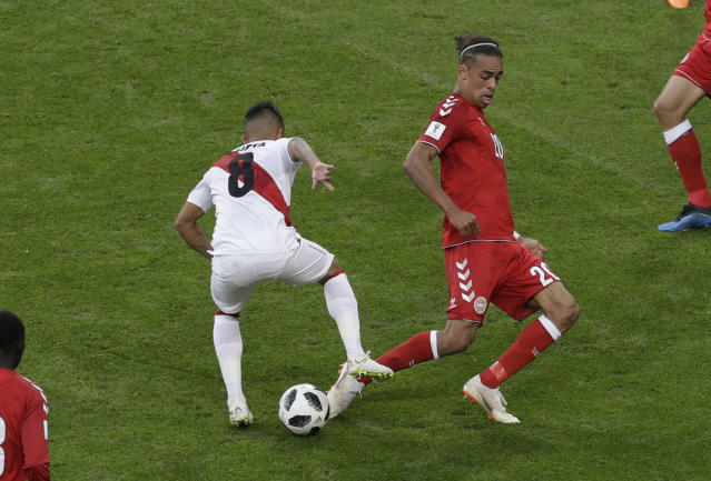 <p>Penalty! Christian Cueva is fouled by Yussuf Yurary Poulsen in the box to give Peru chance to take the lead. (AP) </p>