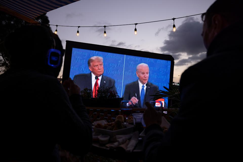 U.S. President Donald Trump and  Democratic presidential candidate Joe Biden's presidential debate is broadcast and watched at a tavern in San Diego, California, U.S., October 22, 2020.   REUTERS/Mike Blake