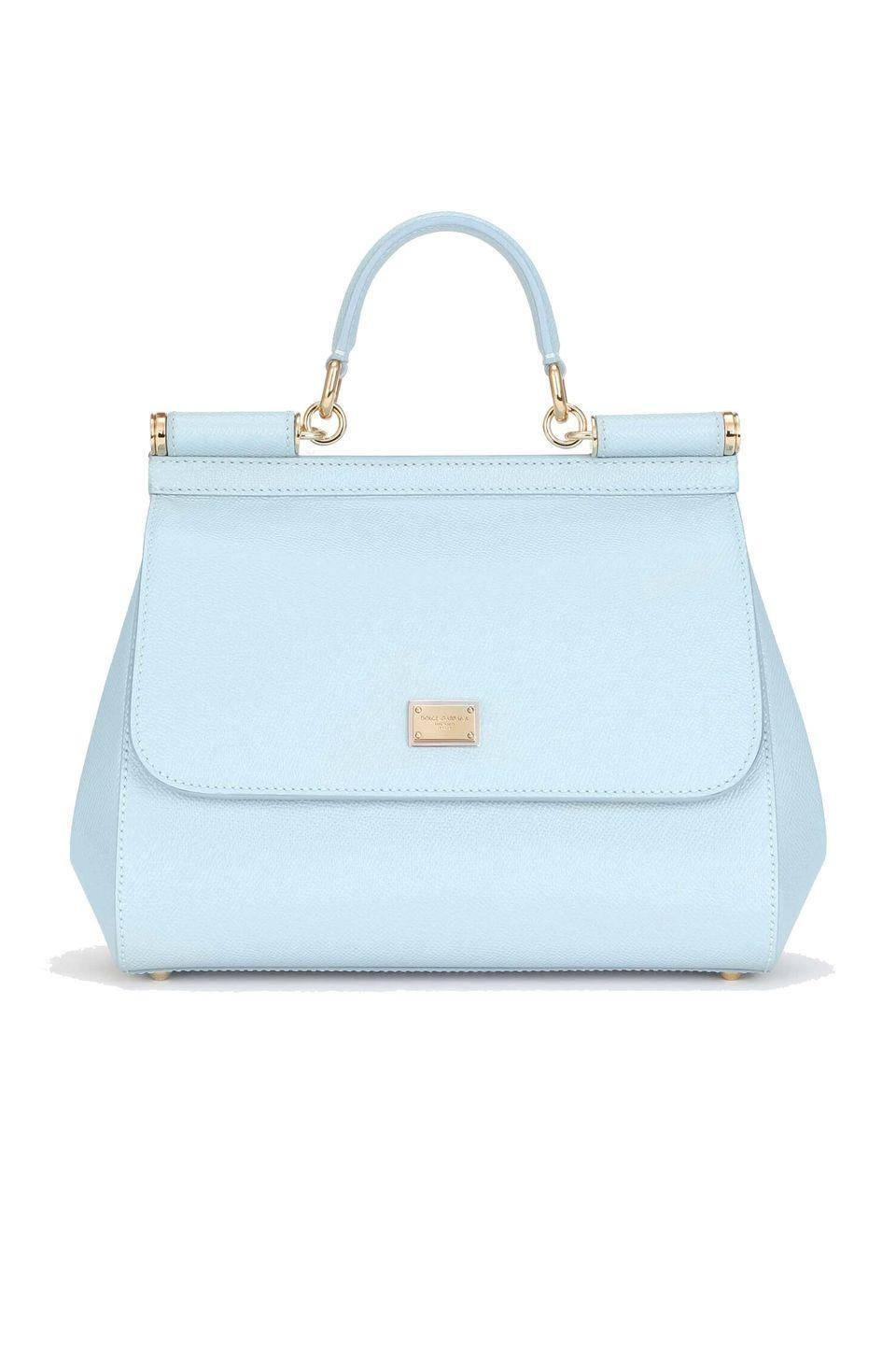 """<p><a class=""""link rapid-noclick-resp"""" href=""""https://www.dolcegabbana.com/en/women/bags/handbags/medium-sicily-bag-in-dauphine-calfskin-azure-BB6002A10018H682.html"""" rel=""""nofollow noopener"""" target=""""_blank"""" data-ylk=""""slk:SHOP NOW"""">SHOP NOW</a></p><p>Dolce & Gabana's Sicily bag comes in a number of different pastel hues, and is a year-round winner. The ladylike silhouette means it can dress up any ensemble, but it is also the perfect size for carrying around day to day.</p><p>Leather bag, £1,200, <a href=""""https://www.dolcegabbana.com/en/women/bags/handbags/medium-sicily-bag-in-dauphine-calfskin-azure-BB6002A10018H682.html"""" rel=""""nofollow noopener"""" target=""""_blank"""" data-ylk=""""slk:Dolce & Gabbana"""" class=""""link rapid-noclick-resp"""">Dolce & Gabbana</a></p>"""
