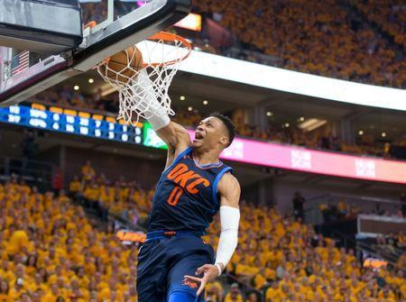 Apr 27, 2018; Salt Lake City, UT, USA; Oklahoma City Thunder guard Russell Westbrook (0) dunks the ball during the first half of game six of the first round of the 2018 NBA Playoffs against the Utah Jazz at Vivint Smart Home Arena. Mandatory Credit: Russ Isabella-USA TODAY Sports