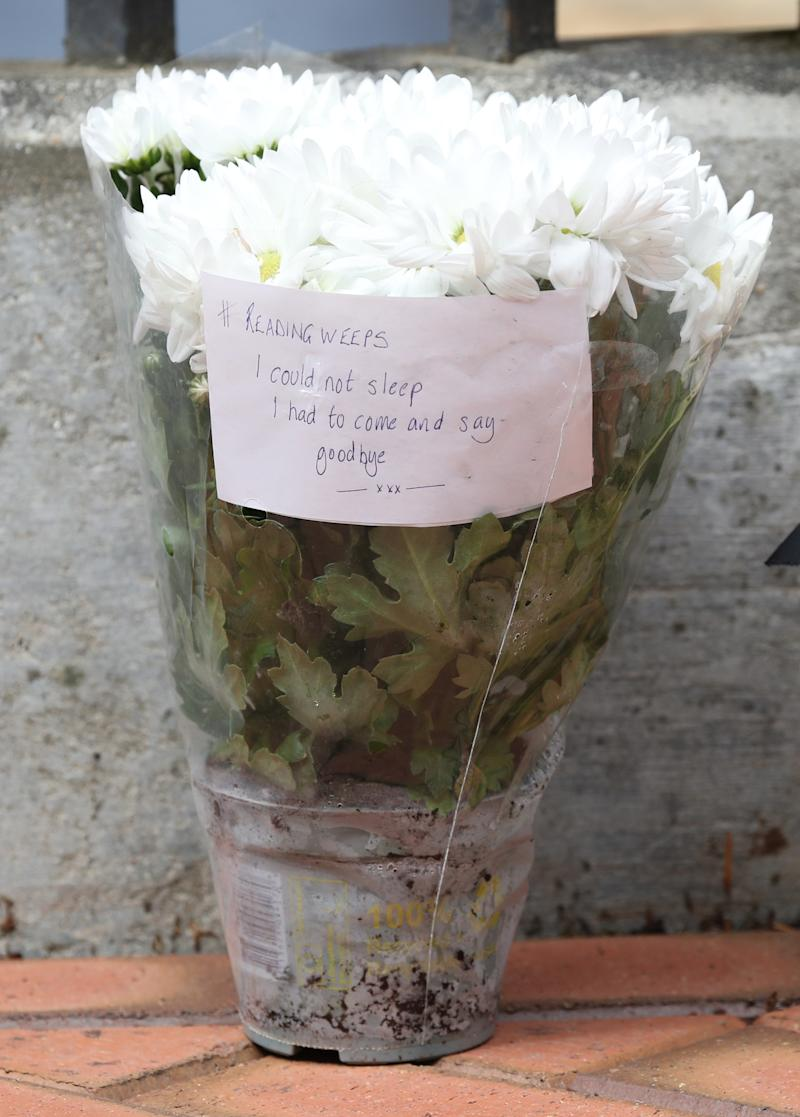 Flowers have been left at the Abbey gateway of Forbury Gardens following the multiple stabbing on Saturday. (PA)