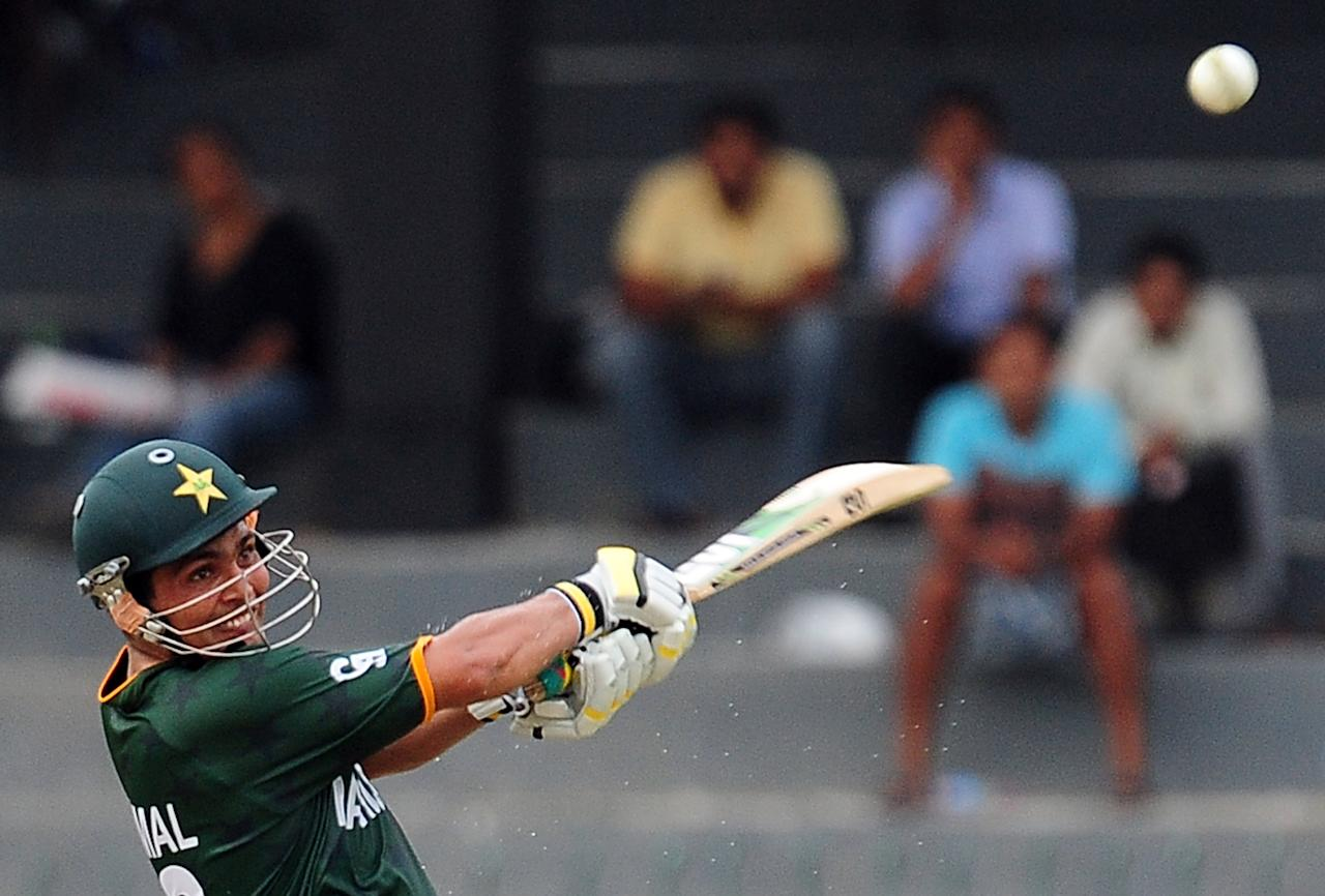 Pakistan cricketer Kamran Akmal plays a shot during a World Twenty20 warm-up match between India and Pakistan at The R. Premadasa Cricket Stadium in Colombo on September 17, 2012. AFP PHOTO/ LAKRUWAN WANNIARACHCHI