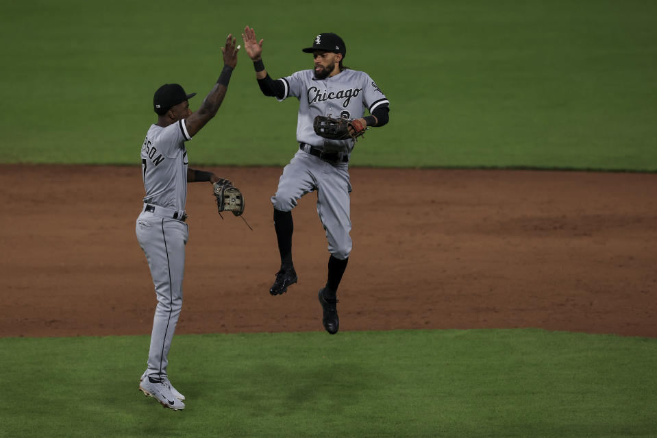 Chicago White Sox Tim Anderson, left, celebrates with Billy Hamilton after the final out of the ninth inning of a baseball game against the Cincinnati Reds, Tuesday, May 4, 2021. (AP Photo/Aaron Doster)