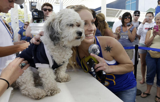 Ashley Alfredson, of Kenosha, Wis., poses for a photo with the Milwaukee Brewers unofficial mascot, Hank, during an exhibition spring baseball game against the Cincinnati Reds, Saturday, March 15, 2014, in Phoenix. (AP Photo/Morry Gash)