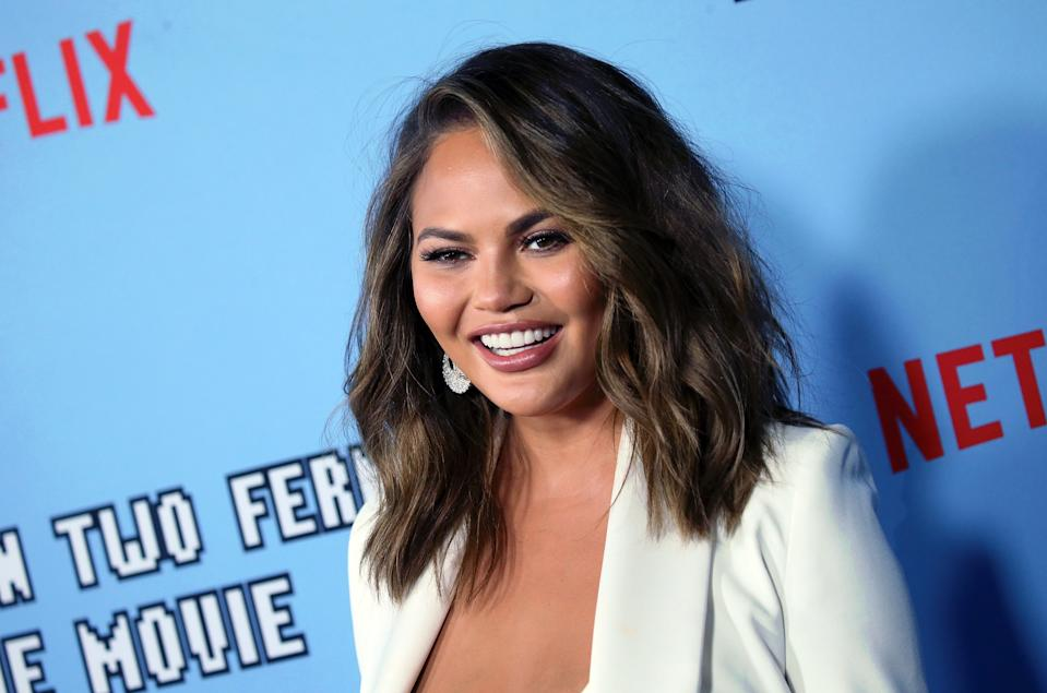"Chrissy Teigen says she on ""serious bed rest"" in her third pregnancy."