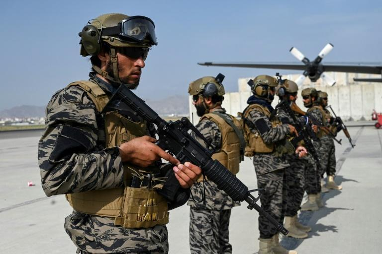 Taliban troops at Kabul's airport: Will China or Russia see the Taliban's seizure of power in Afghanistan as a sign of US weakness? (AFP/WAKIL KOHSAR)
