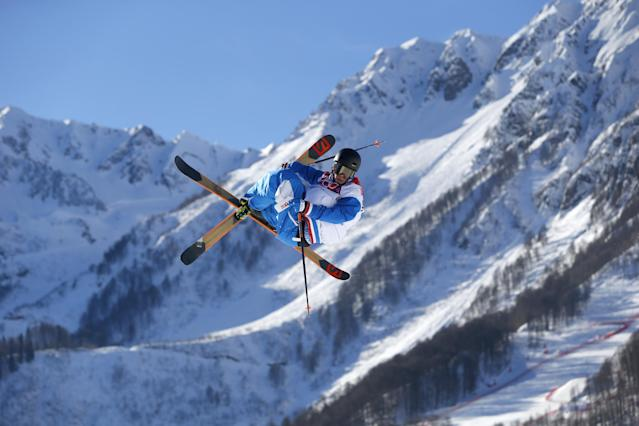 France's Antoine Adelisse competes in the men's ski slopestyle qualifying at the Rosa Khutor Extreme Park, at the 2014 Winter Olympics, Thursday, Feb. 13, 2014, in Krasnaya Polyana, Russia. (AP Photo/Sergei Grits)