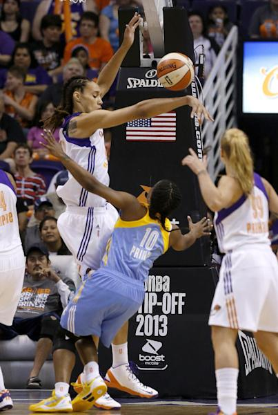 Chicago Sky's Epiphanny Prince (10) gets her shot blocked by Phoenix Mercury's Brittney Griner, left, as Mercury's Samantha Prahalis (99) looks on in the first half during a WNBA basketball game on Monday, May 27, 2013, in Phoenix. (AP Photo/Ross D. Franklin)