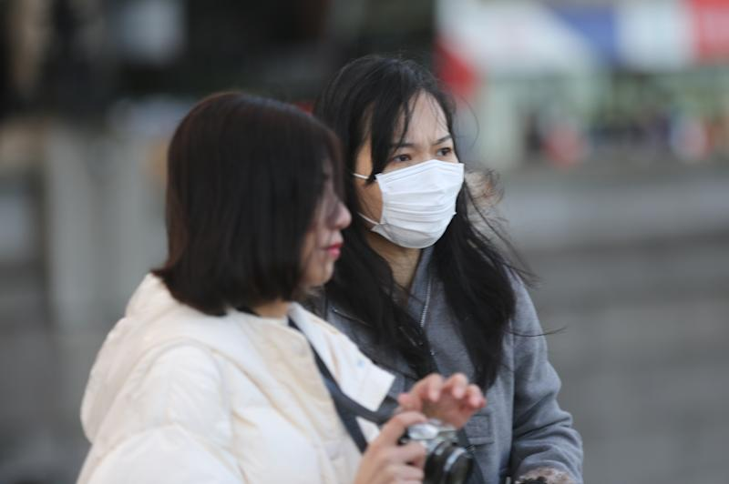 LONDON, UNITED KINGDOM - MARCH 02: A woman wears a medical mask in a street in London, England on March 02, 2020. Four more patients in England have tested positive for coronavirus today, taking the total number of UK cases to 40. (Photo by Ilyas Tayfun Salci/Anadolu Agency via Getty Images)