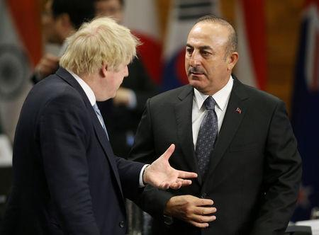 Britian's Secretary of State for Foreign Affairs Boris Johnson speaks with Turkey's Minister of Foreign Affairs Mevlut Cavusoglu during the Foreign Ministers' Meeting on Security and Stability on the Korean Peninsula in Vancouver, British Columbia, Canada January 16, 2018. REUTERS/Ben Nelms