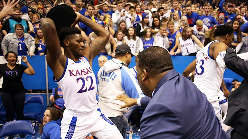 Silvio De Sousa of the Kansas Jayhawks picks up a chair during a brawl as the game against the Kansas State Wildcats ends at Allen Fieldhouse. (Photo by Jamie Squire/Getty Images)
