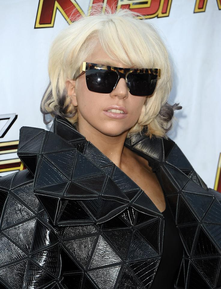 <p>Wearing her hair in a curled bob with swept over bangs, bleached brows and a nude glossy lip, Lady Gaga attends the 102.7 KIIS-FM's Wango Tango in California. (2009)</p>