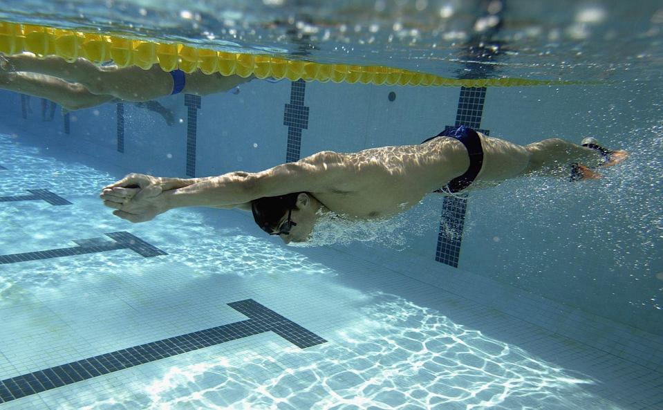 <p>Even during off-Olympic years, Phelps was constantly training and competing. Here, he is seen practicing in a French training facility before representing the United States at the 2003 World Swimming Championships in Barcelona, Spain. </p>