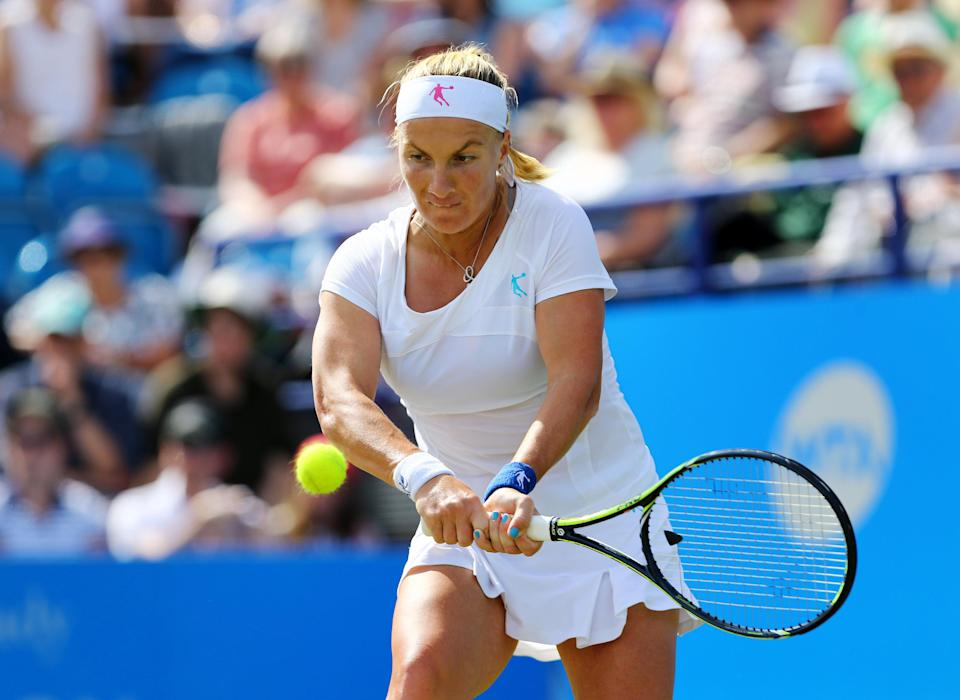 Russia's Svetlana Kuznetsova plays a return to Denmark's Caroline Wozniacki during day five of the AEGON International tennis tournament at Devonshire Park, Eastbourne, England, Wednesday, June 24, 2015. (Gareth Fuller/PA Wire via AP) UNITED KINGDOM OUT, NO SALES, NO ARCHIVE