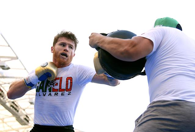 Canelo Alvarez works with his trainer during a media workout at the Banc of California Stadium on Aug. 26, 2018 in Los Angeles. (Getty)
