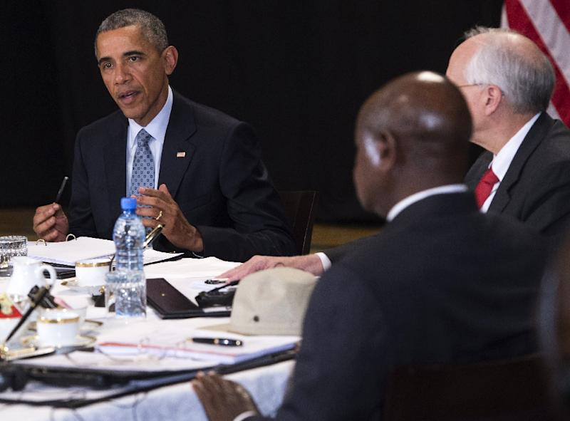 US President Barack Obama (L) speaks during a meeting with Uganda President Yoweri Museveni (C) and US Special Envoy to Sudan and South Sudan Donald Booth in Addis Ababa on July 27, 2015