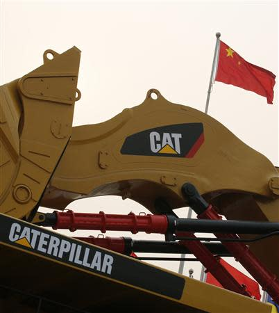A Caterpillar excavator is displayed at the China Coal and Mining Expo 2013 in Beijing October 22, 2013. REUTERS/Kim Kyung-Hoon