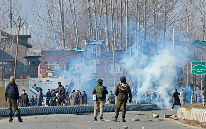 Kashmiri protesters pelt stones towards Indian security personnel  - TAUSEEF MUSTAFA/AFP via Getty Images