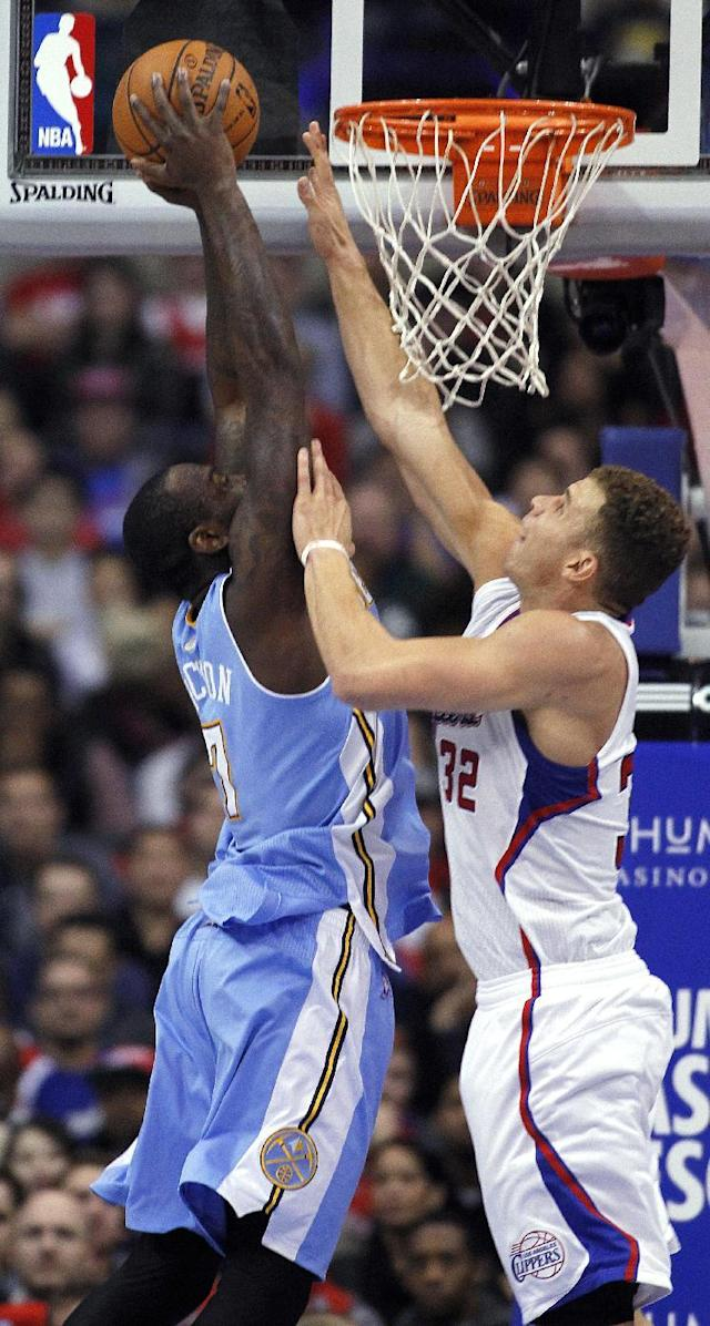 Denver Nuggets forward J.J. Hickson, left, goes up to the basket with Los Angeles Clippers forward Blake Griffin (32) defending during the first half of an NBA basketball game in Los Angeles on Saturday, Dec. 21, 2013. (AP Photo/Alex Gallardo)