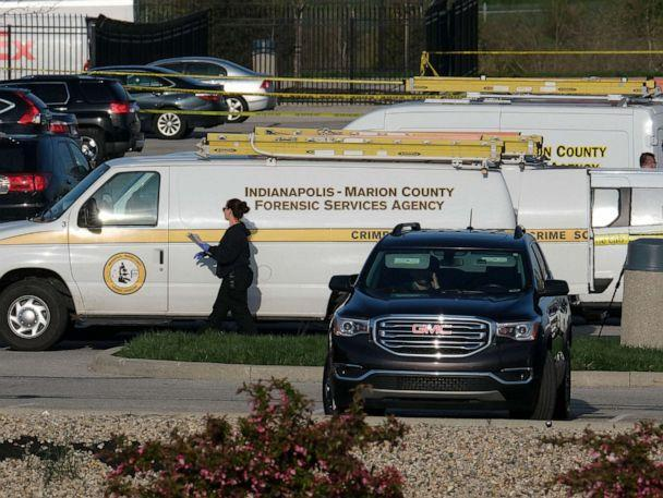 PHOTO: Marion County Forensic Services vehicles are parked at a FedEx facility in Indianapolis, April 16, 2021. (Jeff Dean/AFP via Getty Images)