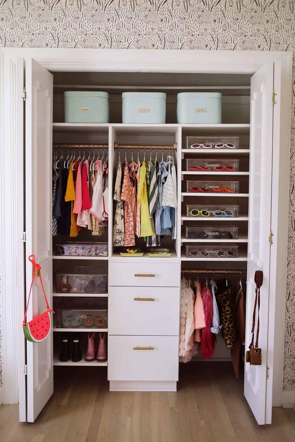 "<p>If you use bins or baskets to keep smaller items and accessories corralled, be sure to label everything clearly, so you know exactly where to find what you need. It's also a great way to keep track of baby clothes, since you can label all of the different sizes within the drawers. </p><p>See more at <a href=""https://abeautifulmess.com/how-to-organize-a-baby-closet-with-the-home-edit/"" rel=""nofollow noopener"" target=""_blank"" data-ylk=""slk:A Beautiful Mess"" class=""link rapid-noclick-resp"">A Beautiful Mess</a>.</p>"