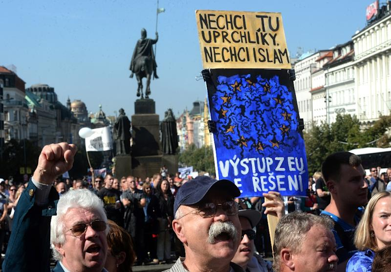 Protesters hold a banner reading '' I do not want refugees and Islam in Czech Republic. Get out of EU is the solution'', during an anti-migrants rally on September 12, 2015 in Prague