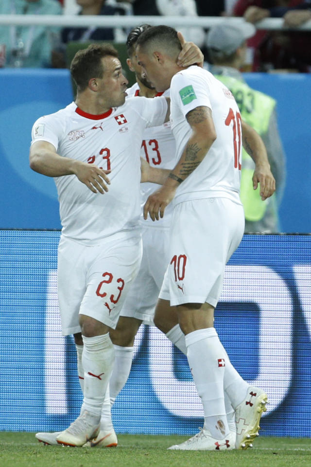 Switzerland's Granit Xhaka, right, celebrates with teammate Xherdan Shaqiri after scoring his side's opening goal during the group E match between Switzerland and Serbia at the 2018 soccer World Cup in the Kaliningrad Stadium in Kaliningrad, Russia, Friday, June 22, 2018. (AP Photo/Victor Caivano)