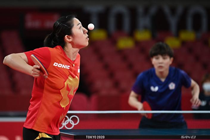 <p>Singapore's Yu MengYu (L) serves to Taiwan's Cheng I-ching during her women's singles round 3 table tennis match at the Tokyo Metropolitan Gymnasium during the Tokyo 2020 Olympic Games in Tokyo on July 27, 2021. (Photo by JUNG Yeon-je / AFP)</p>