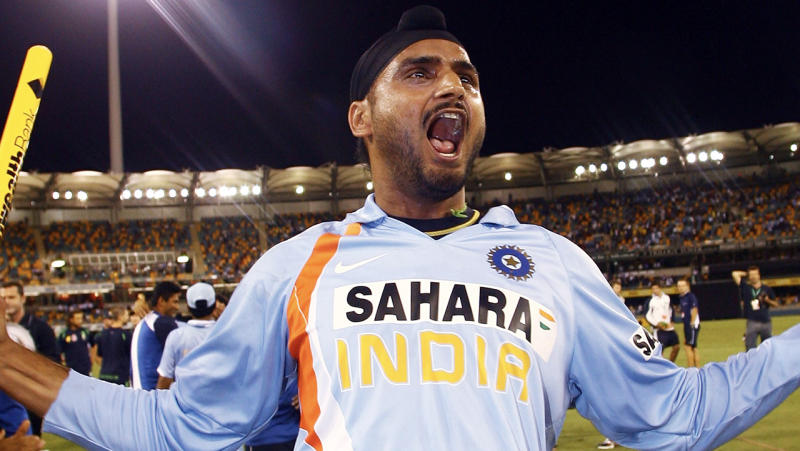 Harbhajan Singh raises his hands and celebrates victory.
