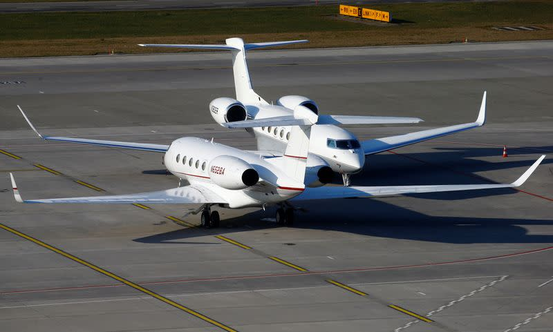 FILE PHOTO: Two Gulfstream GVI G650 GLF6 business aircrafts are parked at the airport in Zurich