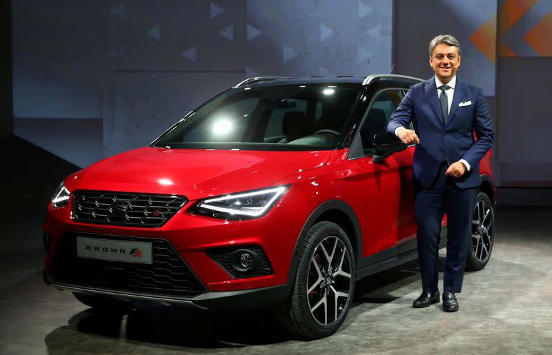 FILE PHOTO: SEAT President and CEO Luca de Meo poses with the new Seat Arona car during a launch event in Barcelona